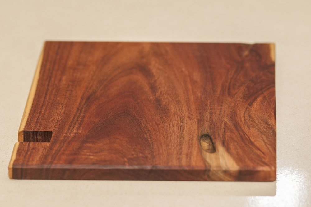 close up wood iphone stand and drink coaster