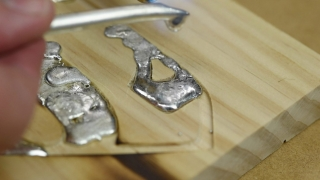 Melted solder in wood